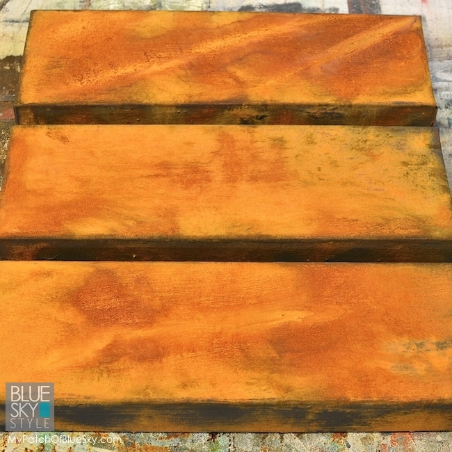 Wood Icing canvas art project using rust, patina and a stencil