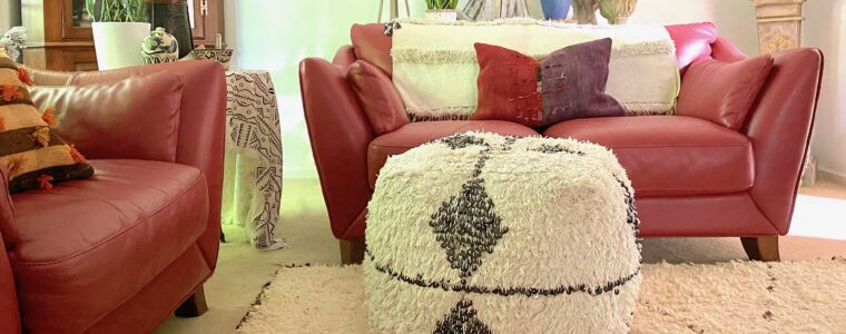 A Moroccan Rug Softens Our Red Leather Den Furniture