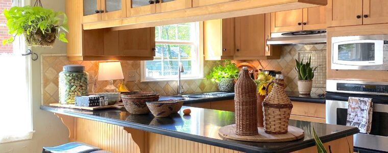Shaker maple kitchen cabinets with seeded glass upper cabinets.