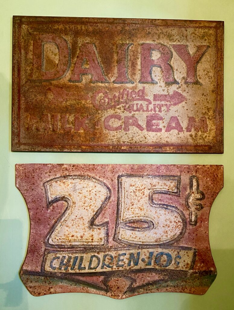 Rusty reproduction dairy signs from Blue Ocean Traders.
